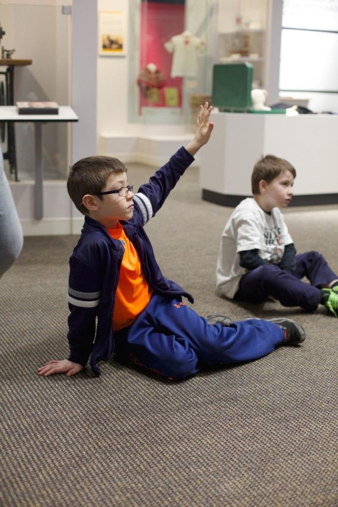 E3 2nd grade boy with hand raised