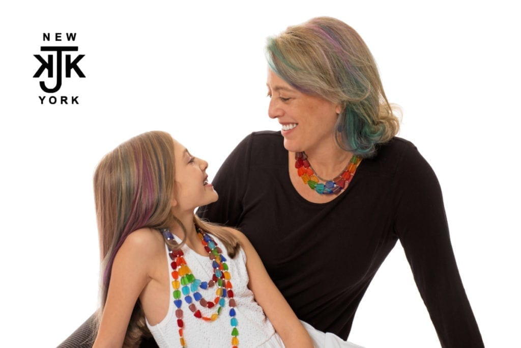 Designer Katherine Kornblau and her daughter smiling