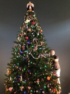 A christmas tree with a smiling man