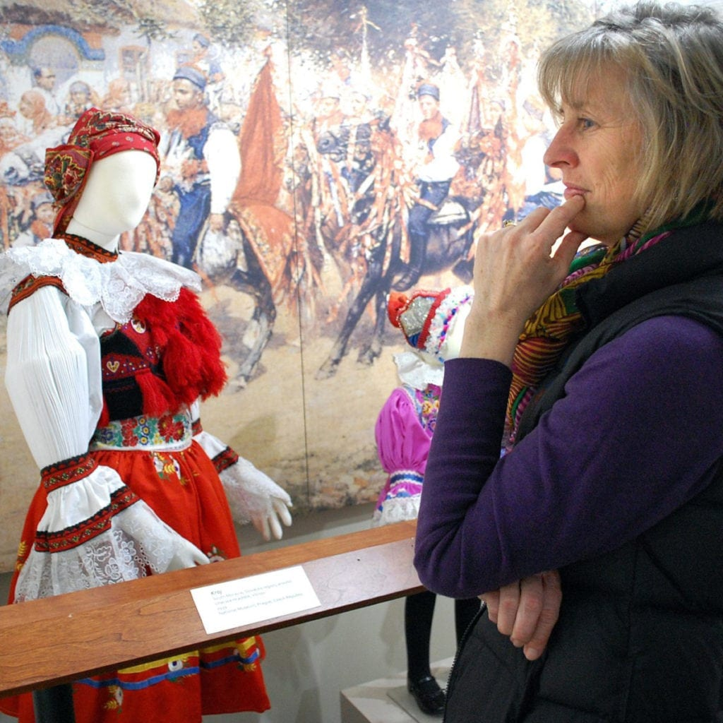 Woman looking at Kroje