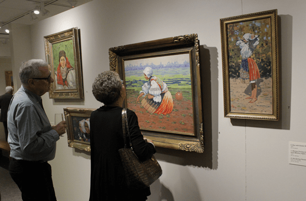 Couple looking at artwork in a gallery