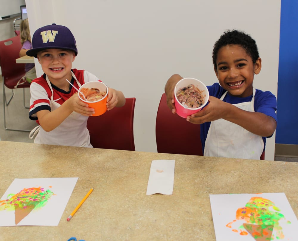 Children eating ice cream and painting