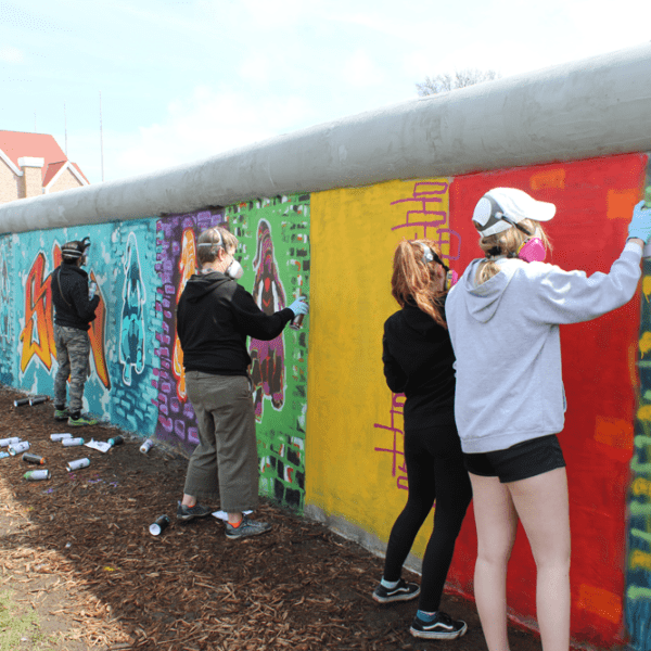 Students painting on the wall