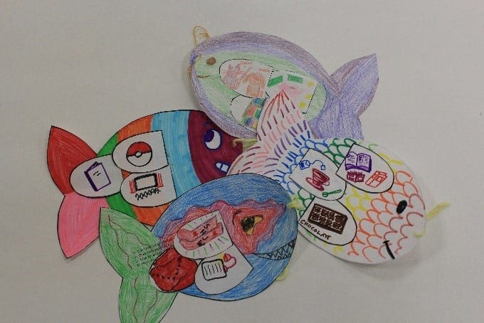 Paper crafts made by children in the shape of a fish